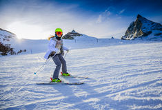 Teenage girl skiing in Swiss Alps. Royalty Free Stock Images