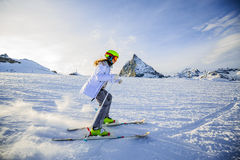 Teenage girl skiing in Swiss Alps in Sunny Day. Teenage girl skiing in Swiss Alps in Sunny Day, Matterhorn in Background Stock Images