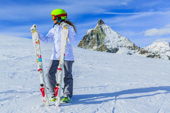 Teenage girl skiing in Swiss Alps in Sunny Day. Teenage girl skiing in Swiss Alps in Sunny Day, Matterhorn in Background Royalty Free Stock Photos