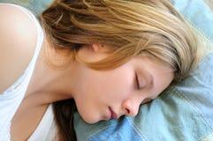 Teenage girl sleeping stock images