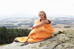 Teenage Girl In Sleeping Bags Admiring View Royalty Free Stock Images
