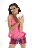 Teenage girl with small baby shoes Stock Photo