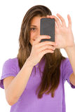 Teenage girl with smartphone Royalty Free Stock Photography
