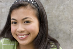 Teenage girl (13-15) smiling, portrait, close-up Royalty Free Stock Image