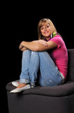 Teenage Girl Smiling Sitting on Chair Royalty Free Stock Photos