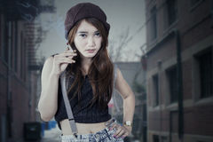 Teenage girl smoking at alley Stock Photography