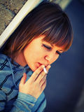 Teenage girl smoking Royalty Free Stock Photo