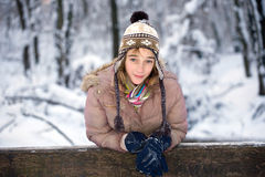 Teenage girl in the snow Royalty Free Stock Image