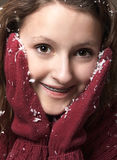 Teenage girl and snow Royalty Free Stock Image