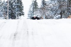 Teenage girl on a snow sled stock photography