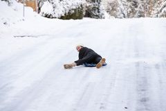 Teenage girl on a snow sled stock images