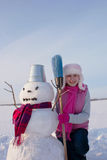 Teenage girl with snowman Royalty Free Stock Photo