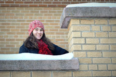 Teenage Girl Snowy Brick Wall Royalty Free Stock Photography