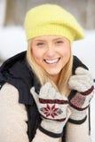 Teenage Girl In Snowy Landscape Stock Photo