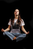 Teenage girl soaring in lotus position Stock Images