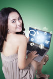 Teenage girl with social media icon on laptop Royalty Free Stock Image