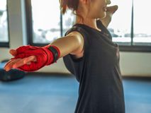 Teenage girl in sports clothes holding a dislocated shoulder on training.  royalty free stock photo