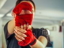 Teenage girl in sports clothes holding a dislocated shoulder on training.  stock image