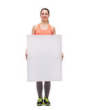 Teenage girl in sportswear with white board Royalty Free Stock Photo
