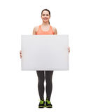 Teenage girl in sportswear with white board Royalty Free Stock Images