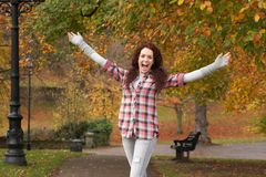 Teenage Girl Standing In Autumn Park Royalty Free Stock Photography
