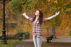 Teenage Girl Standing In Autumn Park. With Arms Outstretched Stock Photography
