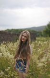 Teenage girl standing in a field of flowers Stock Photography