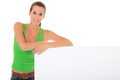 Teenage girl standing next to blank sign Royalty Free Stock Photos