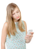 Teenage girl standing with a phone in his hand Royalty Free Stock Image