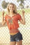 Teenage Girl Standing In Playground Stock Image