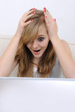 Teenage girl staring surprised at her laptop Stock Photos