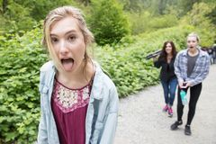 Teenage girl sticking her tongue out royalty free stock photos