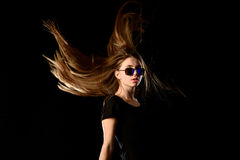 Teenage girl with streaming hair and sunglasses Stock Photos