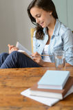 Teenage girl student reading book at home Stock Photos