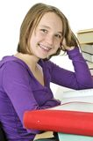 Teenage girl studying. Happy teenage girl studying at the desk royalty free stock images