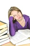 Teenage girl studying. Unhappy teenage girl studying at the desk stock images