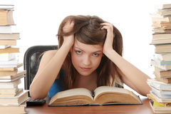Teenage girl studying at the desk Stock Photo