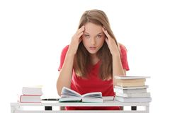 Teenage girl studying at the desk being tired Stock Photos