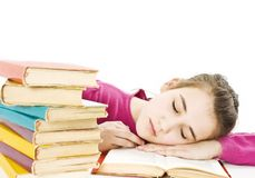 Teenage girl studying at the desk being tired. Stock Photos