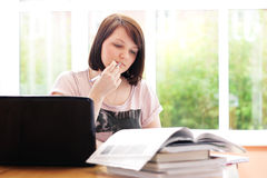 Teenage girl studying at home Stock Image