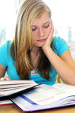 Teenage girl studying with textbooks Royalty Free Stock Image