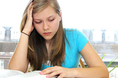 Teenage girl studying with textbooks Stock Images