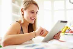 Teenage Girl Studying Using Digital Tablet At Home Stock Image