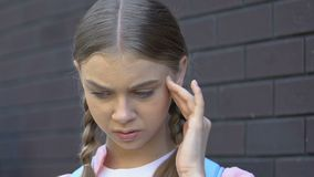 Teenage girl suffering migraine, psychological stress, victim of school bullying. Stock footage stock video footage
