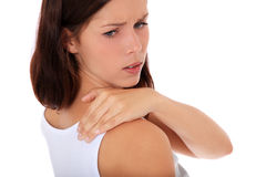 Teenage girl suffers from neck pain Stock Photos