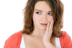 Teenage girl suffers from toothaches Stock Images