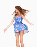 Teenage Girl in Summer Dress with Wind Lifting her Skirt Royalty Free Stock Image