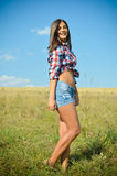 Teenage girl  on summer field Stock Photography