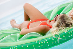 Teenage girl sunbathing Stock Image