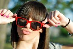 Teenage girl with sunglasses Stock Image